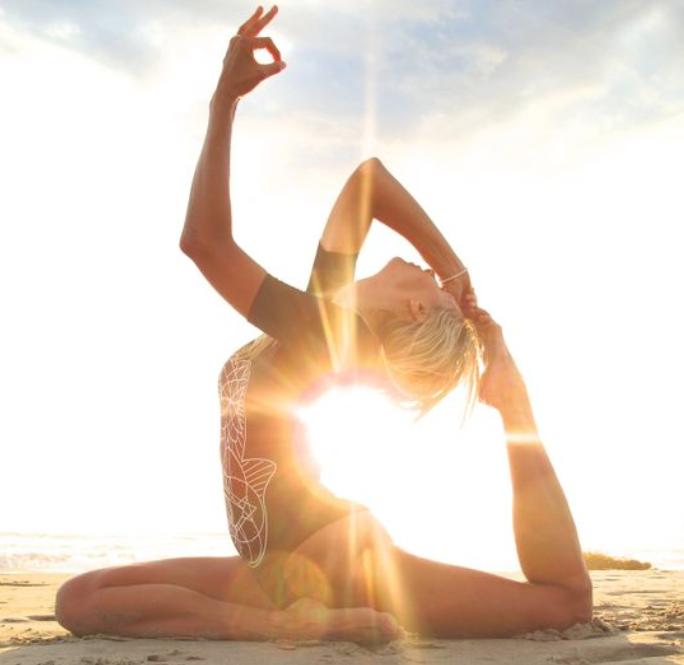 woman-doing-yoga-on-the-beach